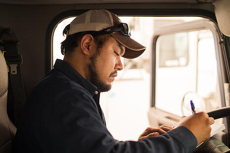 Driver making a checklist in a truck